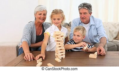 Family playing a building game