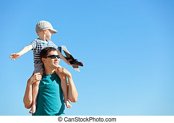 family playing a toy plane - handsome young father and his...