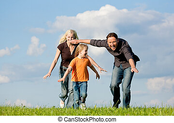 Family playing at a walk