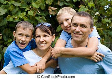 family playing at nature