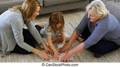 Family playing cards in living room 4k - Family playing ...