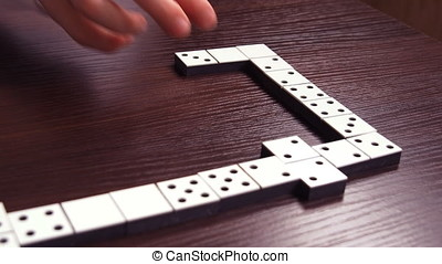 Family playing dominoes. The domino game.