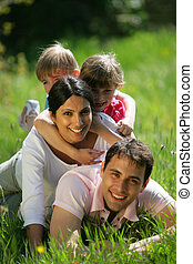 Family playing in the grass