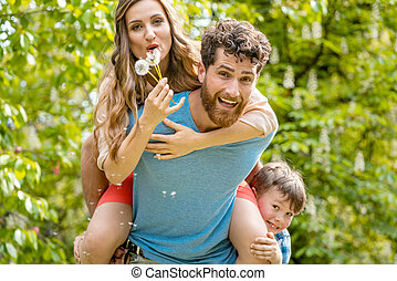 Family playing together outdoors having fun