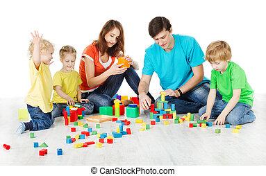 family playing toys blocks