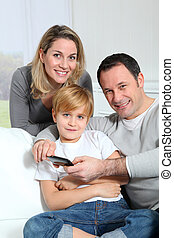 Family playing video game on smartphone