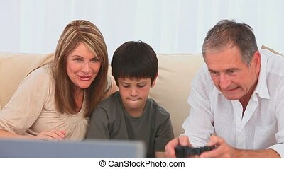 Family playing video games together