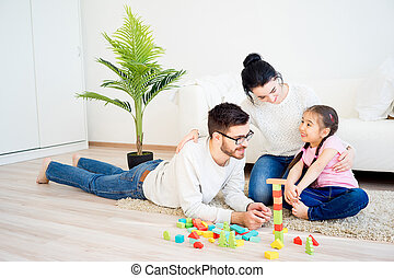 Family playing with toy blocks