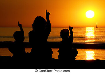 Family Pointing At The Sun