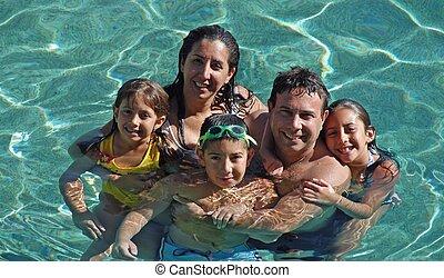 family pool fun - family swimming in pool having fun