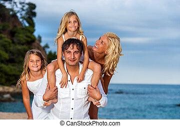 Family portrait at seaside.