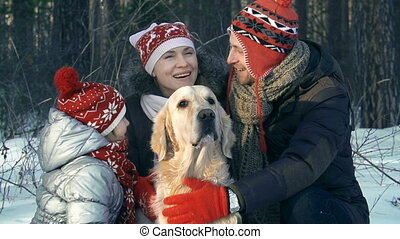 Family Portrait - Close up of family of three petting the...