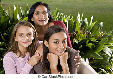 Family portrait, mother with two beautiful daughters