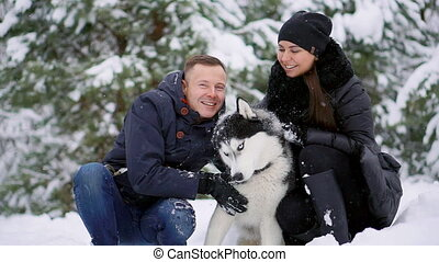 Family portrait of cute happy couple hugging with their...