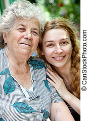 Family portrait of young woman and her grandmother - Family ...