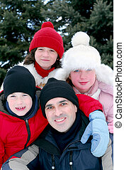 Family portrait - Portrait of a happy family in winter park