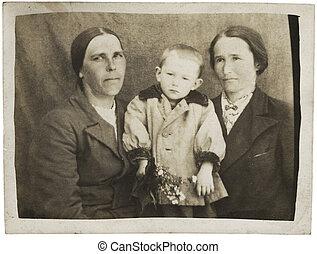 Family Portrait - Two women with a boy. 30-s XX Century,...