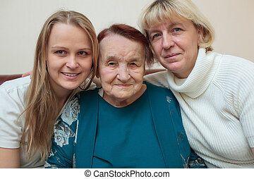 Family portrait with mother, daughter and grandmother - ...