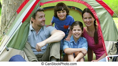 Family posing in their tent
