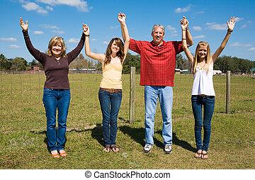 Family Praise & Joy - Beautiful family outdoors on their...