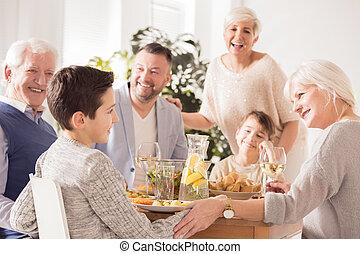 Family praising boy