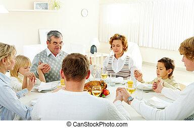 Family pray - Portrait of big family sitting at festive...