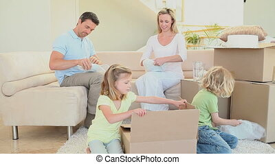 Family preparing boxes to move