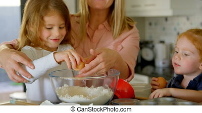 Family preparing food in kitchen 4k