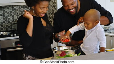 Family preparing food in kitchen at home 4k