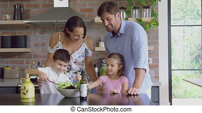 Family preparing food together at table in kitchen at home 4k