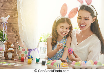 family preparing for Easter - Happy easter! A mother and her...