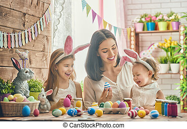 family preparing for Easter - A mother and her daughter are...