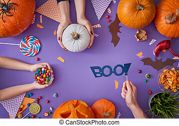 family preparing for Halloween. - Happy halloween! A mother,...