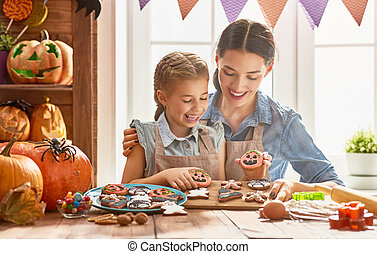 Family preparing for Halloween. - Mother and her daughter...