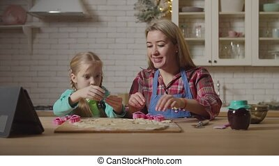 Family preparing homemade cookies in kitchen