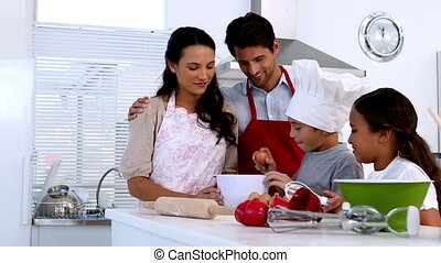 Family preparing pastry together at home in kitchen