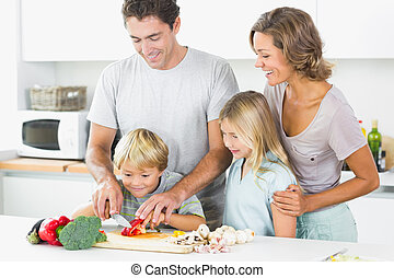 Family preparing vegetables together