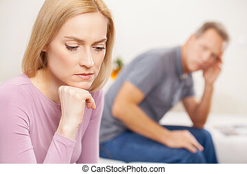 Family problems. Side view of depressed mature woman holding...