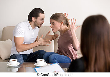 Family psychologist counseling. Couple quarrelling, shouting and