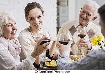 Family raising glasses