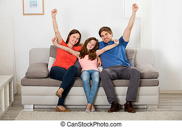 Family Raising Their Arms