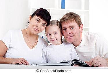 Family reading a book together