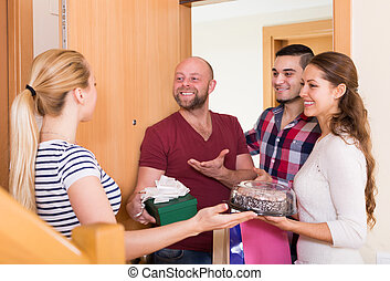 Family receiving visitors - Family couple receiving visitors...
