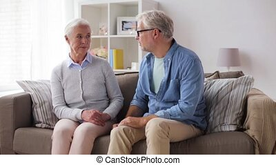 senior couple having argument at home - family, relationship...