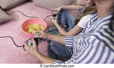 Family relaxed with PC game at home