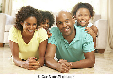Family Relaxing At Home Together