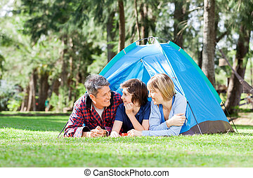 Family Relaxing Inside Tent