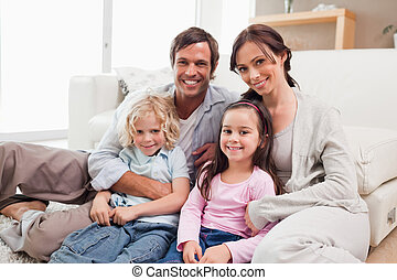 Family relaxing on a sofa