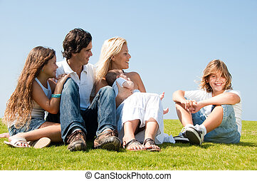 Family relaxing on grass