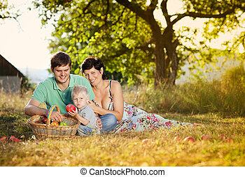 Family relaxing together in nature